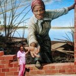 Standing at the mural at the Harriet Tubman Museum in Cambridge, MD. She was born in Dorchester County in March, 1842.